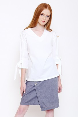 top with ties in a knot detail at sleeves